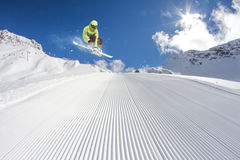 Flying skier on mountains Stock Image