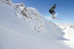 Flying skier on mountains Royalty Free Stock Photos