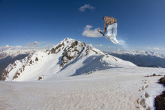 Flying skier on mountains Royalty Free Stock Images