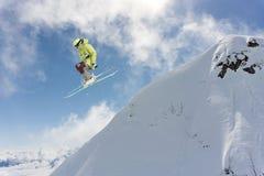 Flying skier on mountains Stock Photos