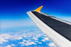 Flying in the sky - Airplane wing flying high in the sky Royalty Free Stock Photos