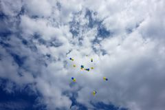 Flying in the sky, blue and yellow balloons. stock photo