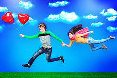 Flying in sky. Couple of young people in love flying in the sky Stock Photo