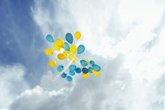 Flying in the sky yellow - blue balls Royalty Free Stock Images