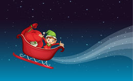A flying sledge and a boy Stock Images