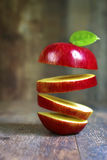 Flying slices of red apple. Stock Photography
