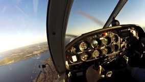 Flying small piston propeller plane stock video