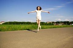 Flying smiling girl Stock Photos