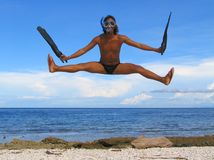 The Flying Snorkeler. Asian male with snorkel gear performing cheer-dance jump at the beach of the marine sanctuary of Apo Islands, Negros Oriental, Philippines Royalty Free Stock Photo