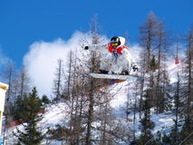 Flying snowboard competitor Stock Photography