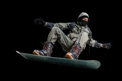 Flying snowboarder isolated on black backgground Royalty Free Stock Images