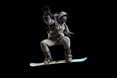 Flying snowboarder isolated on black backgground Stock Image