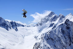 Flying snowboarder on mountains Royalty Free Stock Images