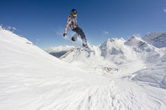 Flying snowboarder on mountains Stock Photography