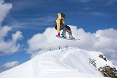 Flying snowboarder on mountains Royalty Free Stock Photos