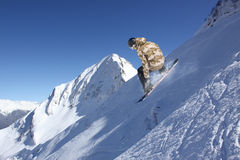 Flying snowboarder on mountains Stock Images