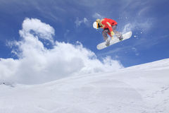 Flying snowboarder on mountains. Extreme sport Stock Images