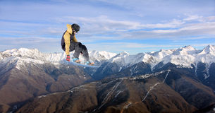 Flying snowboarder on mountains. Extreme sport Stock Photo