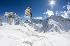 Flying snowboarder on mountains. Extreme sport Stock Image