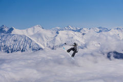 Flying snowboarder on mountains Royalty Free Stock Image