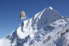 Flying snowboarder on mountains, extreme sport Royalty Free Stock Photography