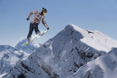 Flying snowboarder on mountains, extreme sport Stock Photos