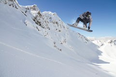 Flying snowboarder on mountains, extreme sport Royalty Free Stock Photo