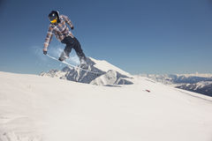 Flying snowboarder on mountains, extreme sport Stock Images