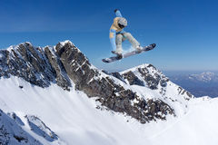 Flying snowboarder on mountains, extreme sport Stock Image