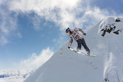Flying snowboarder on mountains, extreme sport Royalty Free Stock Photos