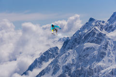 Flying snowboarder on mountains, extreme sport. Flying snowboarder on mountains, extreme winter sport Royalty Free Stock Photo