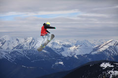 Flying snowboarder on mountains, extreme sport. Flying snowboarder on mountains, extreme winter sport Stock Image