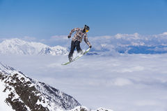 Flying snowboarder on mountains, extreme sport. Flying snowboarder on mountains, extreme winter sport Stock Images