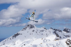 Flying snowboarder on mountains, extreme sport. Flying snowboarder on mountains, extreme winter sport Royalty Free Stock Photos