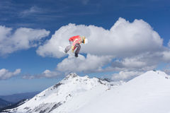 Flying snowboarder on mountains. Extreme sport Stock Photography