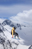 Flying snowboarder on mountains. Extreme sport Royalty Free Stock Photography
