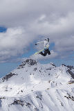 Flying snowboarder on mountains. Extreme sport Royalty Free Stock Photo