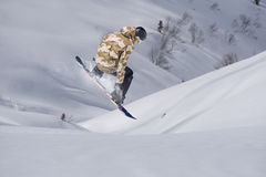 Flying snowboarder on mountains. Extreme sport Stock Photos