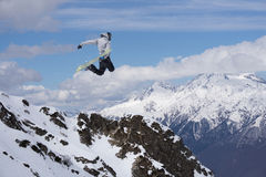 Flying snowboarder on mountains. Extreme sport. Royalty Free Stock Photo