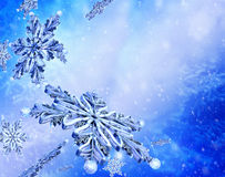 Flying snowflake on blue snow background. Royalty Free Stock Photo