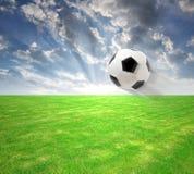 Flying soccer ball. On soccer field stock images