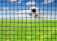 Flying Soccer ball. Soccer ball flying into the goal Stock Photo