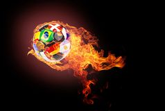 Soccer ball with fire. Flying soccer ball on a dark background with flames Stock Photos