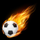 Flying soccer ball on fire - falling down Royalty Free Stock Image
