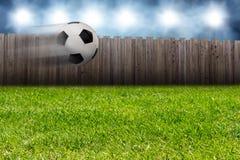 Flying soccer ball in the garden. Flying soccer ball football in the gaden next to the stadium stock photos