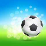 Flying soccer ball over green and blue sky landscape. Football theme vector illustration Royalty Free Stock Photography