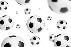 Flying soccer ball. Soccer ball sailing through on white background Royalty Free Stock Photo