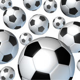 Flying Soccer Balls. Flying soccer ball in the air falling from many directions as a team sporting concept for international and European football game as a fun Stock Photo