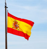 Flying Spain flag Stock Images