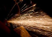 Flying sparks. From under grinder Stock Photo